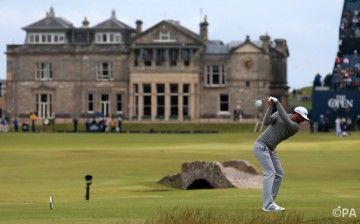 USA's Dustin Johnson tees off the 18th during day one of The Open Championship 2015 at St Andrews, Fife.